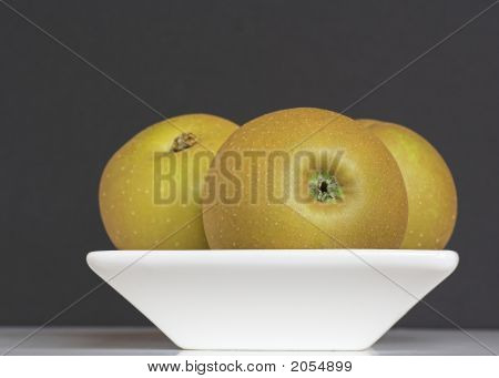 Golden Russet Apples In A Bowl