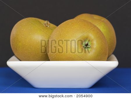Golden Russet Apples In A White Bowl