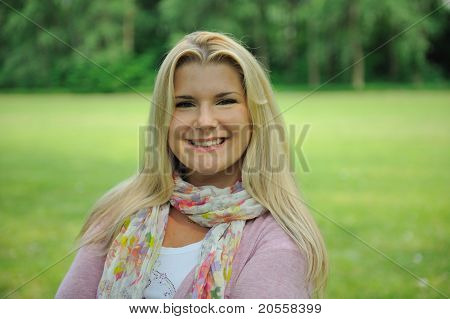 Pretty Casual Woman Outdoors In Green Park Smiling