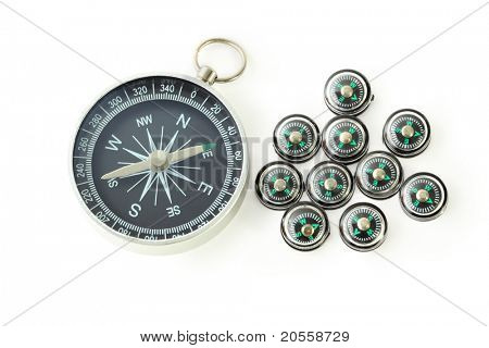 big compass with ten black small compasses isolated on white