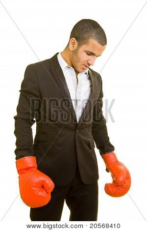 Business Man With Boxing Gloves Looking Down