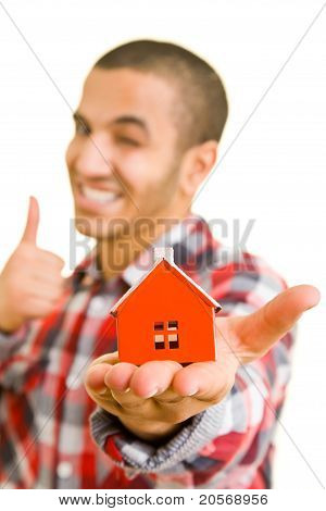 Man With House Holding Thumbs Up