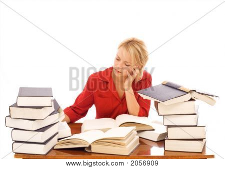 Woman Studiyng With Lots Of Books