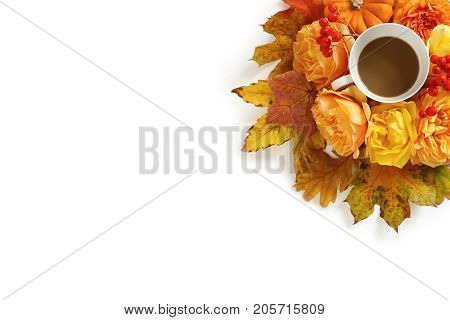 Styled stock photo.with cup of coffee and floral composition made of colorful autumn leaves, orange pumpkin, roses and rowan berries isolated on white background, flat lay, top view.