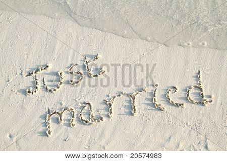 'just Married' Written In Sand.