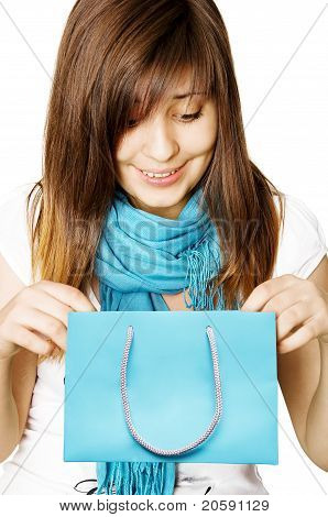 Surprised Girl With Blue Shopping Bag