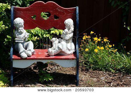 Wooden bench in a flower garden