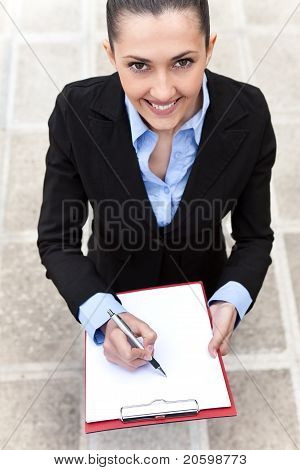 Businesswoman Making Note