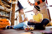 Sweets For Us! Treat Or Trick! Friendly Small Kids In Carnival Head Wear, With Colorful Treats, Near poster