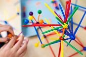 Two Little Girls Playing With Lots Of Colorful Plastic Sticks Kit Indoors. Kids Having Fun With Buil poster