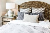 Closeup Of New Bed Comforter With Decorative Pillows, Headboard In Bedroom In Staging Model Home, Ho poster