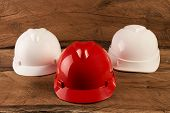 Three Construction Helmets poster