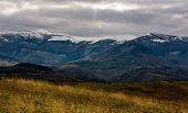 Snowy Mountain Ridge In Late Autumn poster