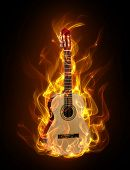 stock photo of acoustic guitar  - Acoustic guitar in fire and flames on black background - JPG