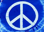 stock photo of peace-sign  - Real tye dye Peace Symbol on cotton knit material - JPG