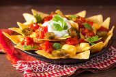 nachos loaded with salsa, cheese and jalapeno poster
