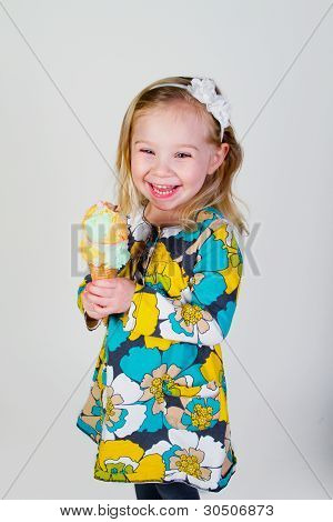 smiling little girl holding ice cream cone