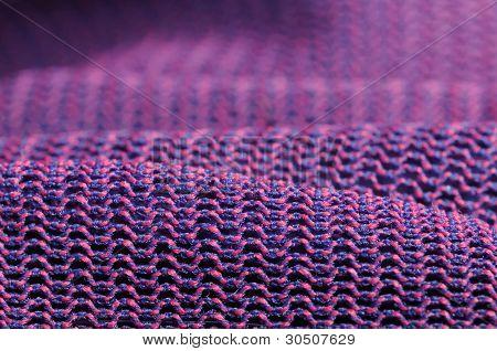 Textura de la tela de color rosa y púrpura de la Macro