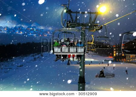 People Ride In The Chairlift At Night