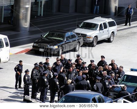 Group Of Police Officers Gather To Discuss Tactics