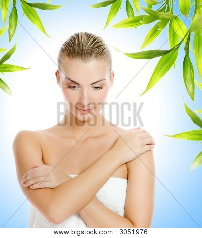 Young Beautiful Woman Over Floral Bamboo Background