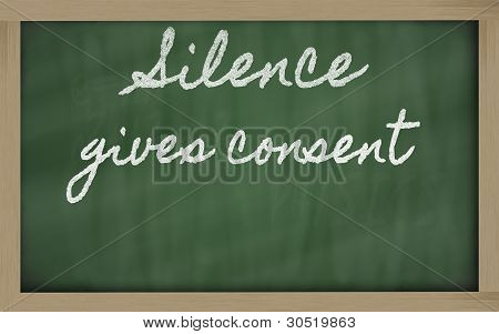Expression -  Silence Gives Consent - Written On A School Blackboard With Chalk