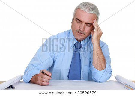 senior architect at desk working