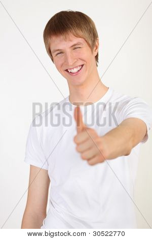portrait of happy young blond man wearing white T-shirt on white background