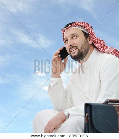 Middle Eastern businessman speaking on phone