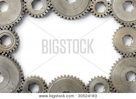 Background image with a frame made of old cog gear wheels.