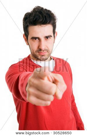 Portrait of a handsome young man pointing finger at you against white background