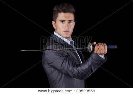 Poderoso empresário segurando uma espada ninja (isolada em preto)
