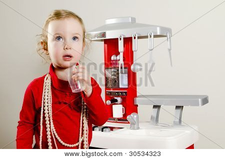 Little Cute Girl Playing In Children's Kitchen.