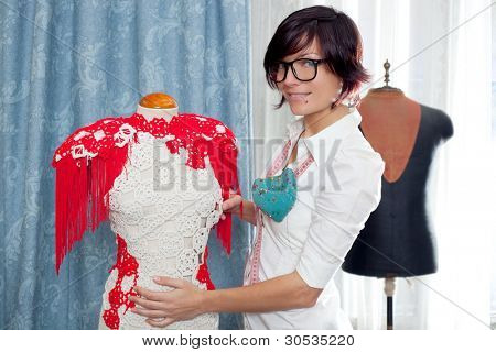 Dressmaker with mannequin as professional fashion designer