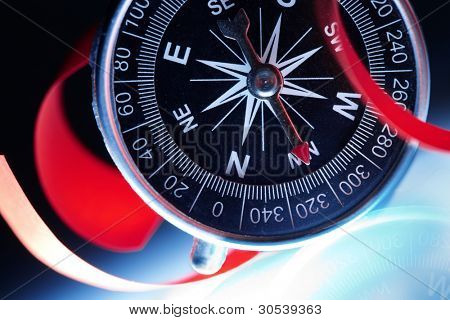 Compass composition for traveler, conceptual colorphoto, suitable also as a background image