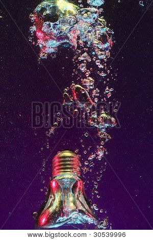 electric lightbulb falling into water