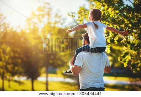 poster of Concept Of Father's Day! Happy Family Dad And Child Daughter Back  In Nature