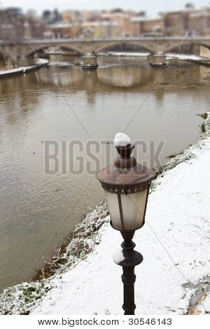 Snowy Shore Of The Tiber River, Rome (italy).