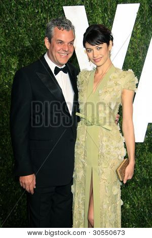 LOS ANGELES - FEB 26:  Danny Huston; Olga Kurylenko arrive at the 2012 Vanity Fair Oscar Party  at the Sunset Tower on February 26, 2012 in West Hollywood, CA