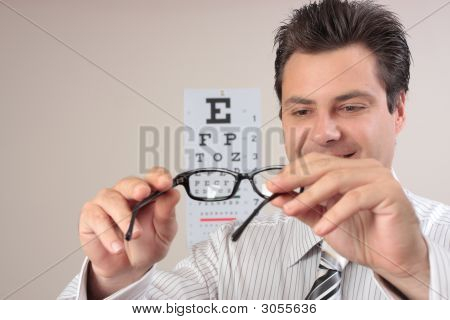 Optometrist Examining Eye Glasses