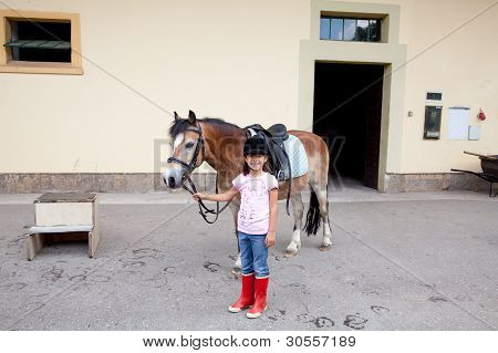 Little Girl Ready For A Horseback Riding Lesson