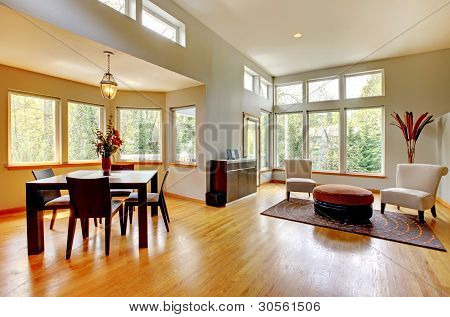 Large Dinng Room And Living Room In A Modern House With Many Windows.