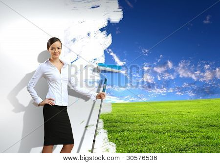 Young businesswoman and nature background