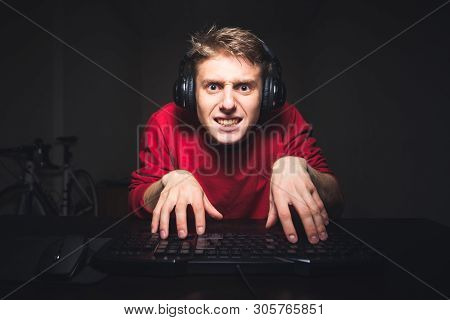 poster of Funny Young Man Typing Text On The Computer With Two Hands And Focusing On The Computer Screen, Sitt