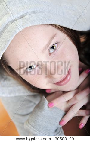 Young girl wearing hoodie looking up