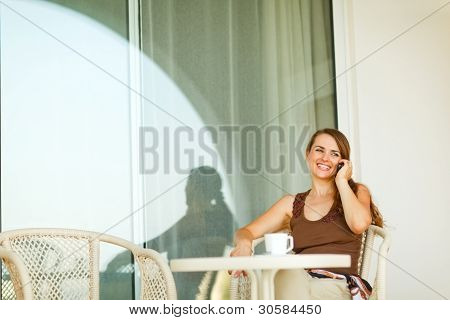 Happy Young Woman Speaking Mobile Phone