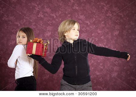 Angry boy throwing gift