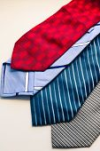 Set Of Fashion Multicolored Mans Ties. Red Blue Gray And Striped Ties On The White Background. poster