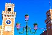 foto of arsenal  - Classic venetian lantern near to beautiful old tower with clocks on Venetian Arsenal Italy - JPG