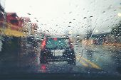 Abstract Traffic In Raining Day. View From Car Seat. Background In Retro Filter. Road View Through C poster